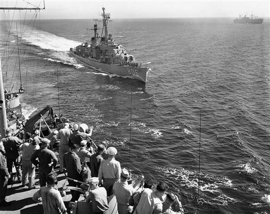 FILE - An American destroyer comes alongside a flagship to deliver a message as the convoy carries First Cavalry division from Japan to South Korea on July 21, 1950. (AP Photo/Charles P.Gorry, File) Photo: Charles P Gorry / AP