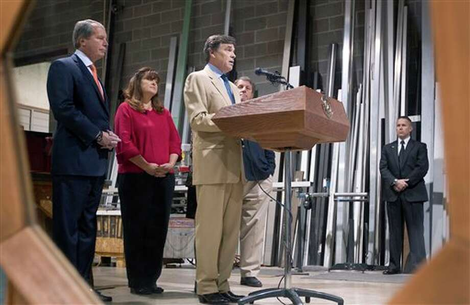 """Gov. Rick Perry and Lt. Gov. David Dewhurst visit an East Austin glass company on Tuesday, Nov. 13, 2012 to discuss reforms to welfare and unemployment insurance programs. A bill filed before the Texas Legislature reconvenes in January would mandate drug-testing for """"high-risk"""" welfare applicants while banning them from using public funds to buy alcohol, tobacco and lottery tickets. But Perry and Dewhurst, who controls the flow of legislation through the state Senate, said a top priority should be expanding such rules to include Texans applying for unemployment assistance too. (AP Photo/Statesman.com, Laura Skelding) MAGS OUT; NO SALES; INTERNET AND TV MUST CREDIT PHOTOGRAPHER AND STATESMAN.COM Photo: Laura Skelding / Statesman.com"""