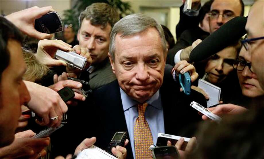 Senate Majority Whip Richard Durbin of Ill., pauses while speaking to the reporters on Capitol Hill Tuesday, Nov. 13, 2012, in Washington, as the lame duck 112th Congress returned. (AP Photo/Alex Brandon) Photo: Alex Brandon / AP