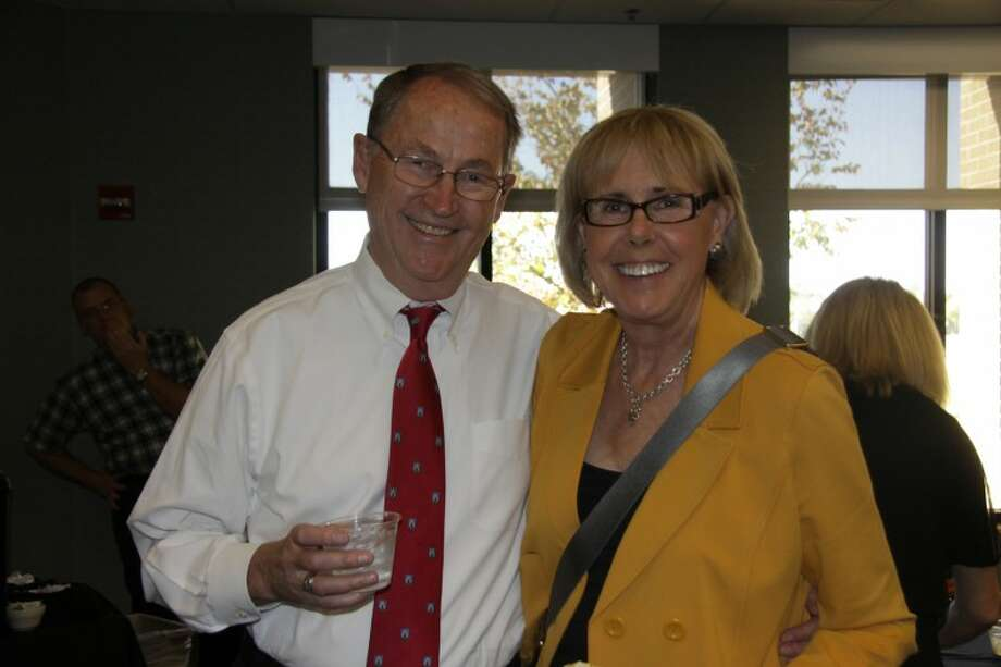 Stan Jacobs, retired vice president of instruction, left, and Deana Savage, special adviser to college president.