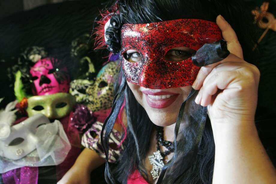 Stephenie Woodall is making masks for the Midland/Odessa Area AIDS Support annual fundraiser dinner and dance that will be held on Oct. 7 at the Midland Country Club. Cindeka Nealy/Reporter-Telegram Photo: Cindeka Nealy