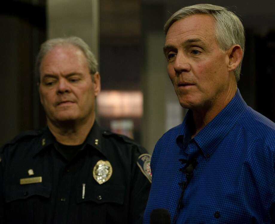 Mayor Wes Perry and Police Chief Price Robinson talk to the media Thursday night about the train accident that killed four people and injured dozens during the Show of Support parade. Tim Fischer\Reporter-Telegram Photo: Tim Fischer