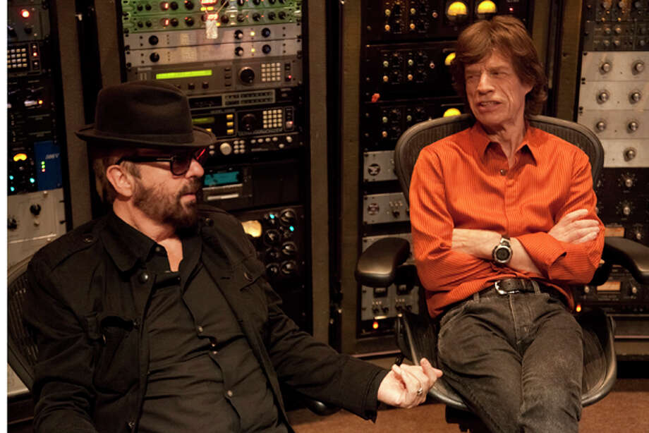 In this 2011 image released by SuperHeavy, Euythmics founder Dave Stewart, left, and Rolling Stones lead singer Mick Jagger of the new band SuperHeavy are shown at Henson Studio in Los Angeles. The band also consists of soulful singer-songwriter Joss Stone, Oscar-winning composer A.R. Rahman and reggae singer Damian Marley. Their first album was released on Tuesday, Sept. 20, 2011. (AP Photo/SuperHeavy, Kristin Burns) Photo: Kristin Burns / SuperHeavy