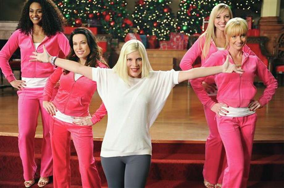 "This image released by ABC Family shows Tori Spelling, center, in a scene from the ABC Family original holiday musical, ""The Mistle-Tones,"" also starring Tia Mowry. The special is part of the network's ""25 Days of Christmas"" Premiering Sunday, Dec. 9 at 8:00 p.m. EST. (AP Photo/ABC Family, Fred Hayes) Photo: Fred Hayes / ABC Family"