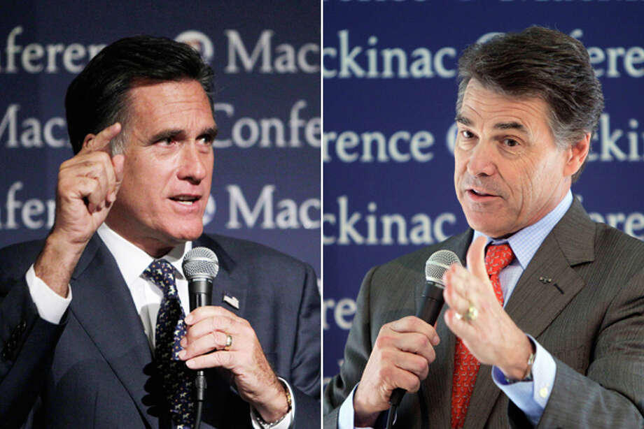In this composite of two Associated Press photos taken Sept. 24, 2011, Republican presidential candidates Mitt Romney and Rick Perry address the Republican Leadership Conference on Mackinac Island, Mich. Call it a personal class war: Perry, the son of a cotton farmer, is trying to draw sharp class lines with his chief GOP presidential rival, the very well-heeled former Massachusetts Gov. Mitt Romney. Photo: Associated Press File