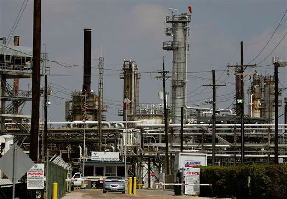In this Sept. 16, 2011 photo, a car leaves the Valero Houston Refinery in Houston. Three commissioners appointed by Gov. Rick Perry may grant some of the nation's largest refineries a tax refund of more than $135 million — money Texas' cash-strapped schools and other local governments have been counting on to help pay teachers and provide other public services. (AP Photo/Pat Sullivan) Photo: Pat Sullivan / AP