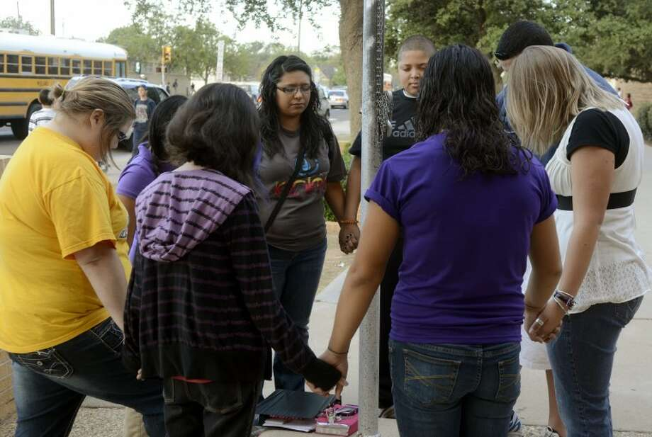 Students gather around the flag pole at Midland High in prayer Wednesday morning for the annual See You at the Pole. Photo by Tim Fischer/Midland Reporter-Telegram Photo: Tim Fischer