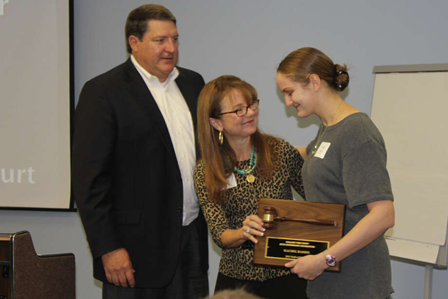 Midland Teen Court Board Vice President Scott Jones and President Kathy Robbins present Midland College student Rachel Harris, right, with a plaque as she is recognized as a 2011 Hall of Honor awardee. Teen Court celebrated its 25th year and recognized volunteers during a breakfast Thursday morning at the Midland ISD administration building. Photo: Meredith Moriak/MRT Staff