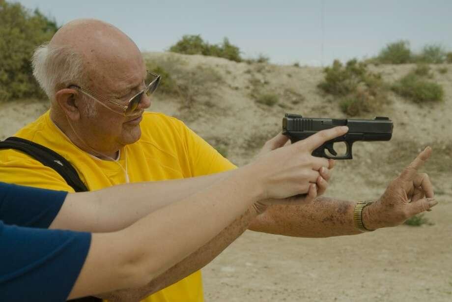 Tom Vannaman, firearms safety instructor and concealed handgun training instructor, talks about handgun safety. Photo by Tim Fischer/Midland Reporter-Telegram Photo: Tim Fischer