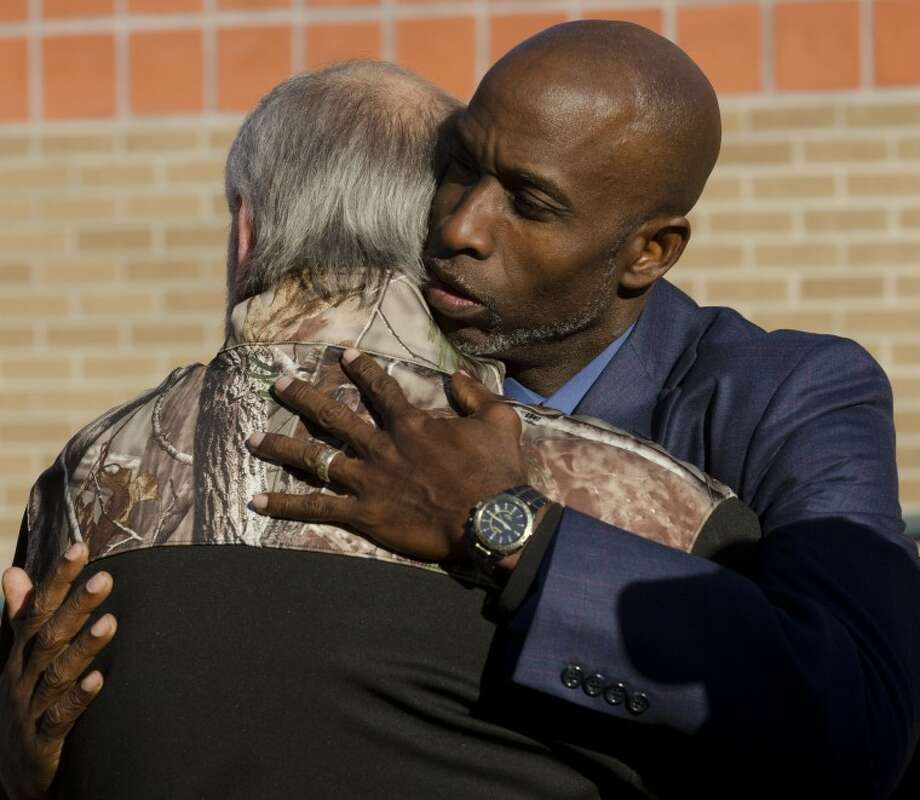 Pastor Roy Smith comforts Terry Johnson Friday morning following a community prayer service for all those involved in the veterans parade accident. Tim Fischer\Reporter-Telegram