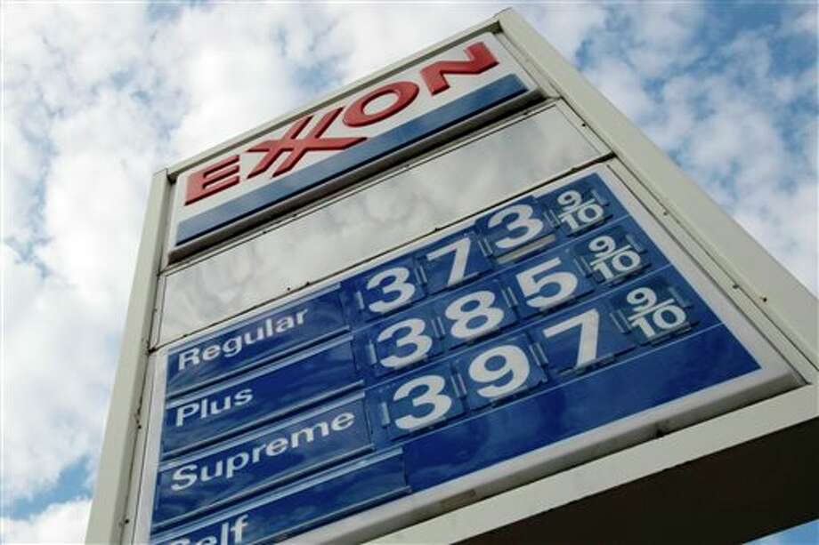 FILE - This Feb. 27, 2012 file photo shows gas prices at a Pittsburgh Exxon mini-mart. Exxon Mobil Corp. reports quarterly financial results before the market open on Thursday, Aug. 1, 2013. (AP Photo/Gene J. Puskar, File) Photo: Gene J. Puskar / AP
