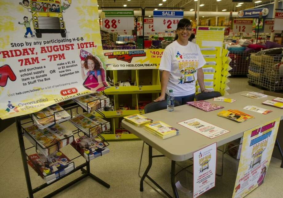 An August 2012 file photo shows Libby Medrano, Midland Freshman High School's Communities in Schools campus coordinator encouraging shoppers at Midland H-E-B to donate school supplies during the annual Stuff the Bus campaign. Photo by Tim Fischer\ Reporter-Telegram Photo: Tim Fischer