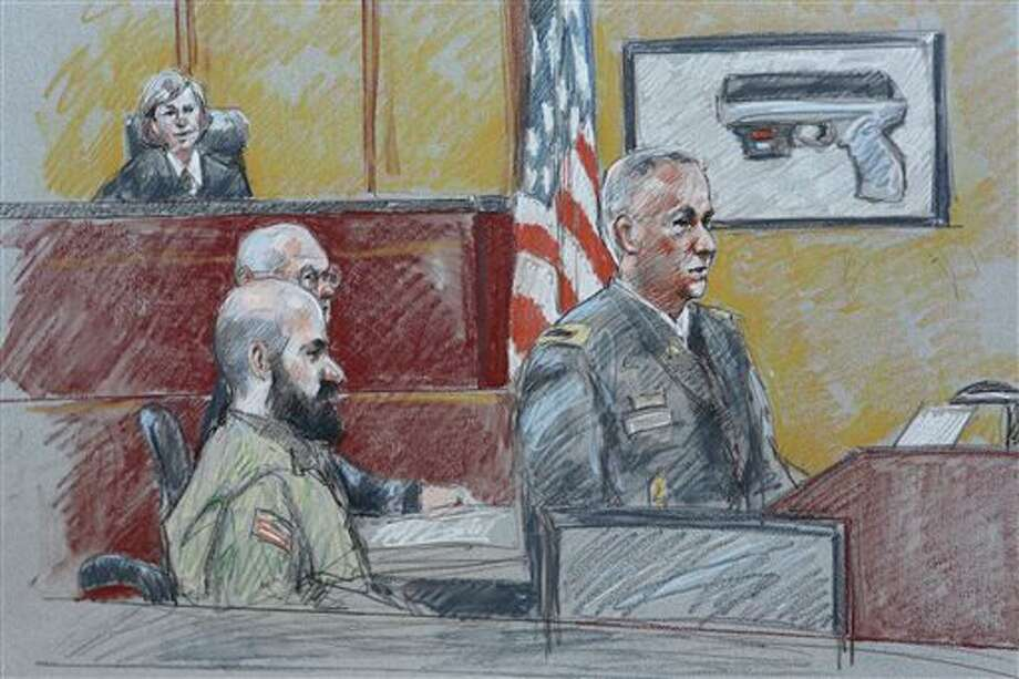 CORRECTS HENRICKS' RANK TO COLONEL INSTEAD OF LT. COLONEL - In this courtroom sketch, military prosecutor Col. Steve Henricks, right, speaks as Nidal Malik Hasan, center, and presiding judge Col. Tara Osborn look on during Hasan's court-martial Tuesday, Aug. 6, 2013, in Forth Hood, Texas. Hasan is representing himself against charges of murder and attempted murder for the 2009 attack that left 13 people dead at Forth Hood. (AP Photo/Brigitte Woosley) Photo: Brigitte Woosley / AP