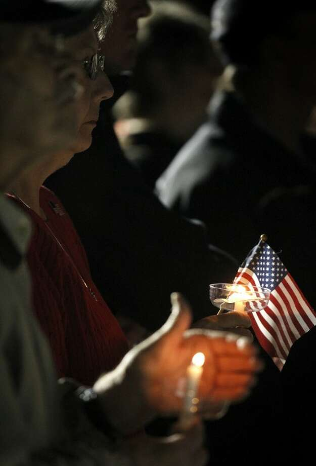 (File Photo) Midlanders gather in Centennial Plaza Saturday for a candlelight vigil held in honor of four veterans who were killed when a freight train hit a parade float Thursday. James Durbin/Reporter-Telegram Photo: JAMES DURBIN