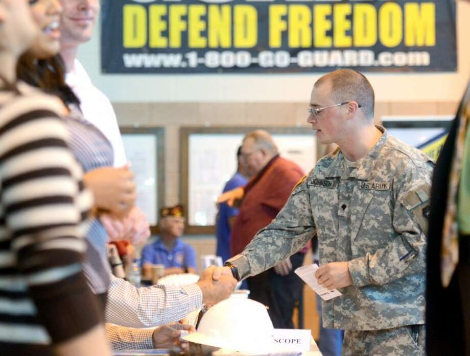 Army National Guardsman Michael Johnson talks with representatives from NOV Tuboscope during a job fair hosted for military veterans by Workforce Solutions Permian Basin Thursday at the National Guard Armory at Midland International Airport. James Durbin/Reporter-Telegram Photo: JAMES DURBIN