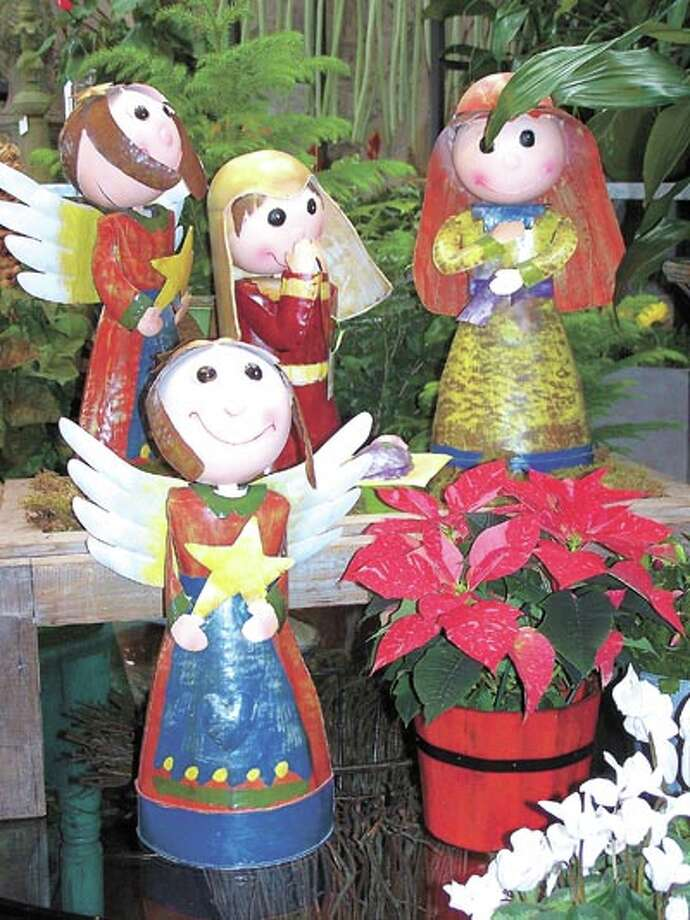 """""""Angels we have heard on high"""" says the hymn, and these angels extend you holiday greetings at Flowerland, 413 Andrews Highway."""