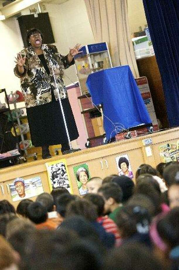 Local storyteller Sue Roseberry -- seen here talking to students at the  former Bunche Early Childhood Center -- will be presenting a series of workshops for students. Photo: File Photo