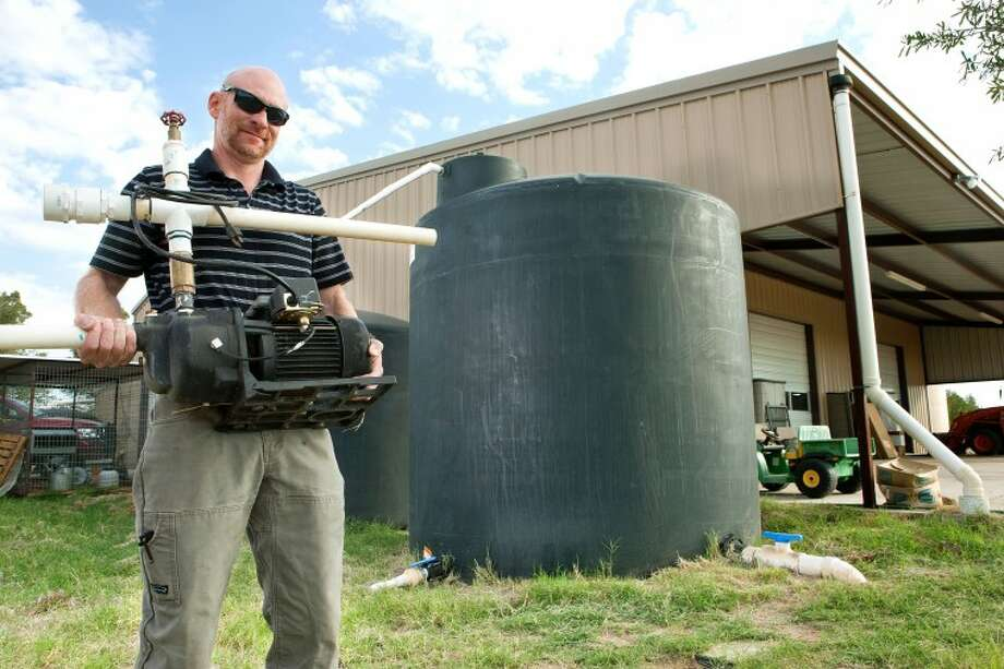 Chris Morrow created a water recycling system that collects rainwater run-off from the roof of his barn and house and collects in tanks. The water is later pumped from the storage tanks to irrigate his landscaping. Photo: Cindeka Nealy/Reporter-Telegram