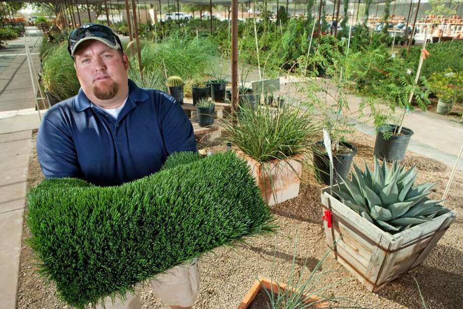 Alldredge Gardens General Manager Justin Smith has seen an increase in artificial turf and native plant sales due to the lack of rainfall and water rationing in the area. Photo: Cindeka Nealy/Reporter-Telegram