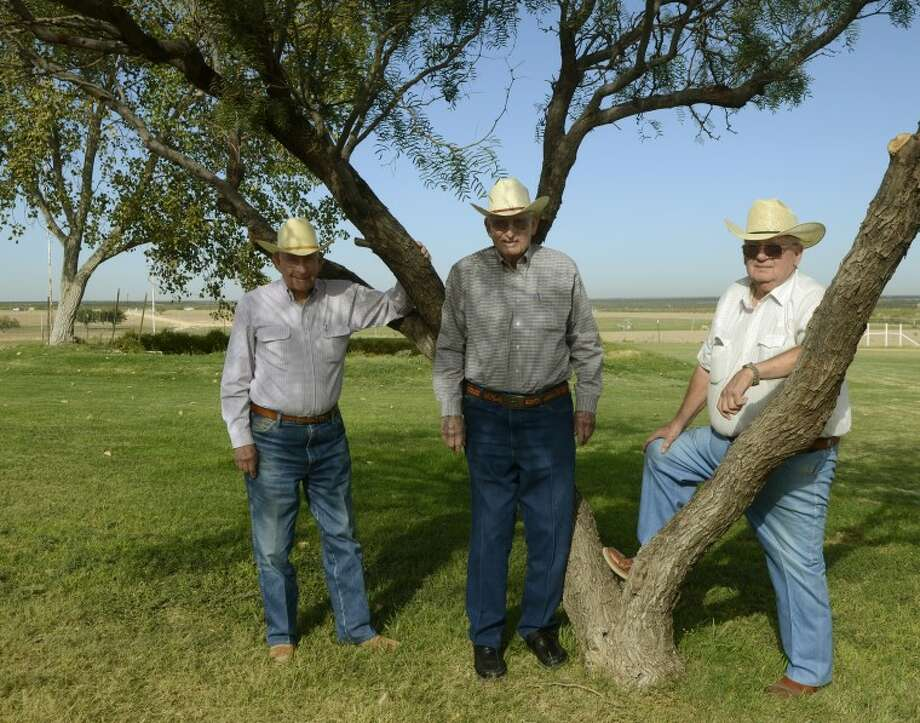 Bob Midkiff, from left, his brother, John, and cousin, T.O. Midkiff, have been in the ranching business since the family home-steaded outside Midland. Photo: Tim Fischer/Reporter-Telegram