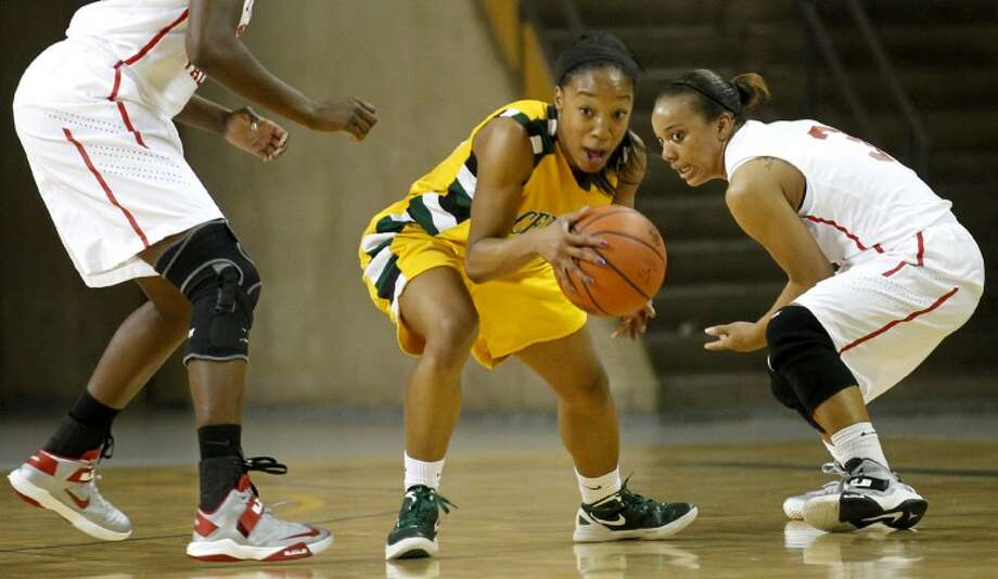 Central Arizona College guard Paris Webb, originally from Midland, steals the ball from Trinity Valley Community College during the Midland College National Invitational Tournament championship game Saturday at the Chaparral Center in Midland. James Durbin/Reporter-Telegram Photo: JAMES DURBIN