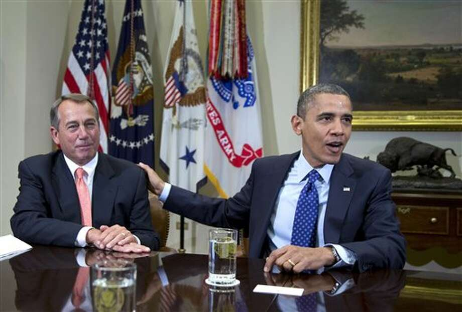 FILE -In this Friday, Nov. 16, 2012, file photo, President Barack Obama acknowledges House Speaker John Boehner of Ohio while speaking to reporters in the Roosevelt Room of the White House in Washington. U.S. stocks shook off their post-election slump Monday and recorded big gains as investors appeared more optimistic about a deal to avoid a federal budget crisis and were encouraged by a pair of corporate earnings reports. (AP Photo/Carolyn Kaster) Photo: Carolyn Kaster / AP