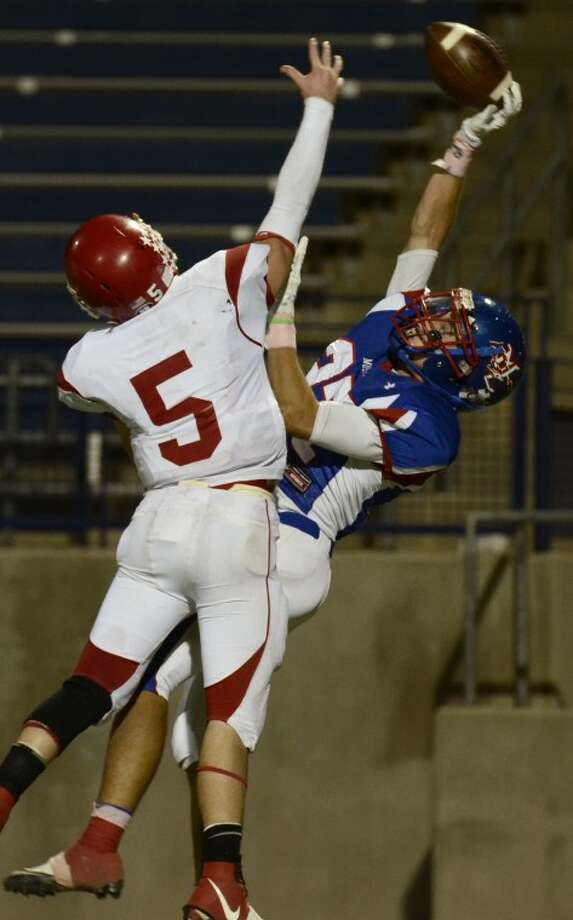 Midland Christian's Landon Lacy gets a hand on the ball but cannot brin it in for a reception as Sweetwater's Taylor Jones defends Friday night at Grande Communications Stadium. Photo by Tim Fischer/Midland Reporter-Telegram Photo: Tim Fischer