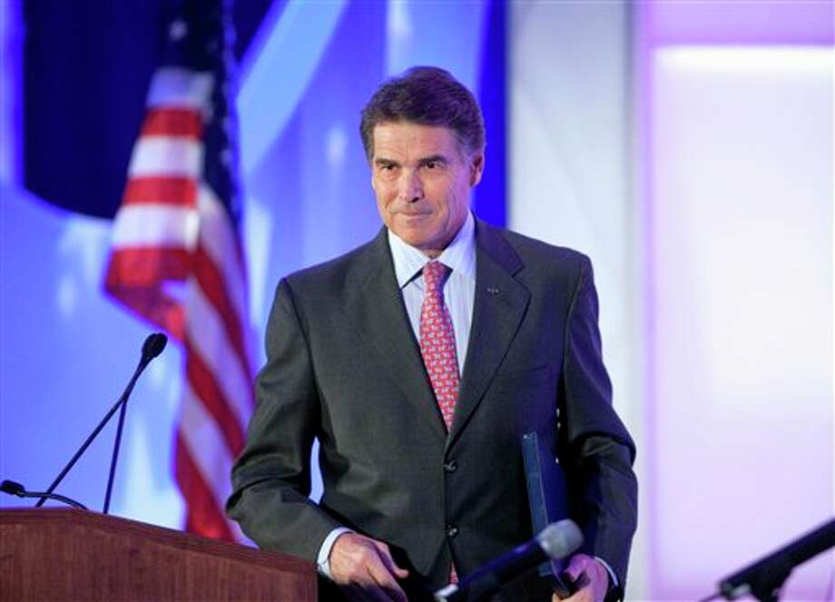 Republican presidential candidate, Texas Gov. Rick Perry leaves to podium after a speech at the Georgia Legislative Briefing, Friday, Sept. 30, 2011, in Atlanta. (AP Photo/David Goldman) Photo: David Goldman / AP