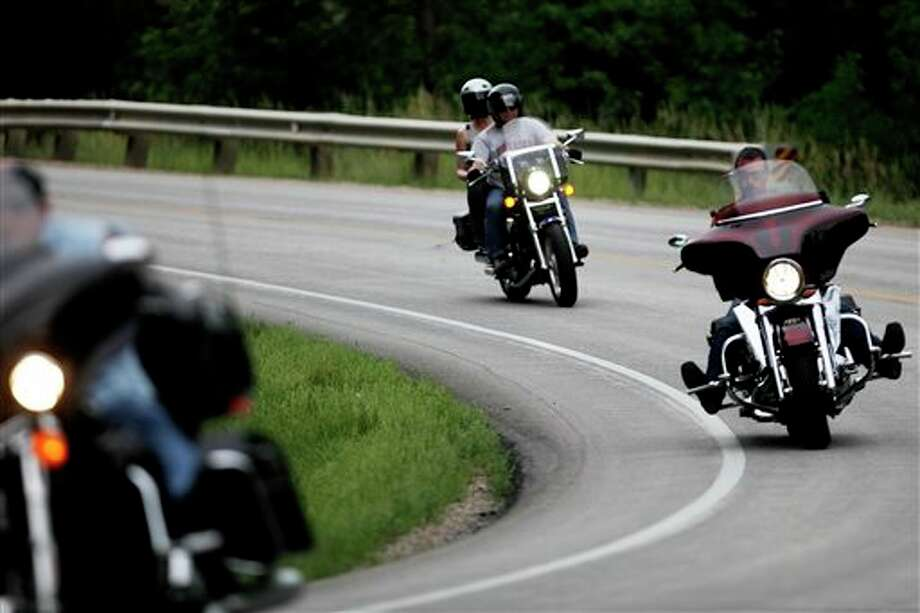 Bikers ride on Nemo Road outside Rapid City, S.D. on Monday, Aug. 5, 2013 on the official first day of the 73rd Sturgis motorcycle rally. Local law enforcement have already reported an increase in traffic citations, drug busts and DUI arrests compared to last year. (AP Photo/Rapid City Journal, Kristina Barker) Photo: Kristina Barker / Rapid City Journal