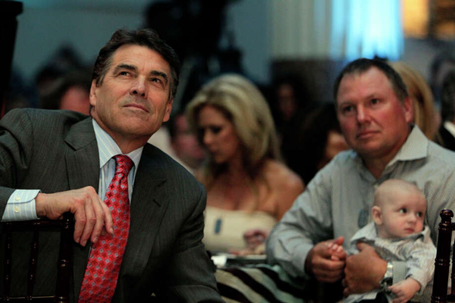 Gov. Rick Perry listens as he is introduced before speaking to an audience of more than 200 during the Lone Survivor Foundation's 2011 Second Annual Gala titled Mission: Never Quit at Minute Maid Park Saturday, Sept. 17, 2011, in Houston. (AP Photo/ Houston Chronicle, Johnny Hanson) Photo: Johnny Hanson / © 2011 Houston Chronicle