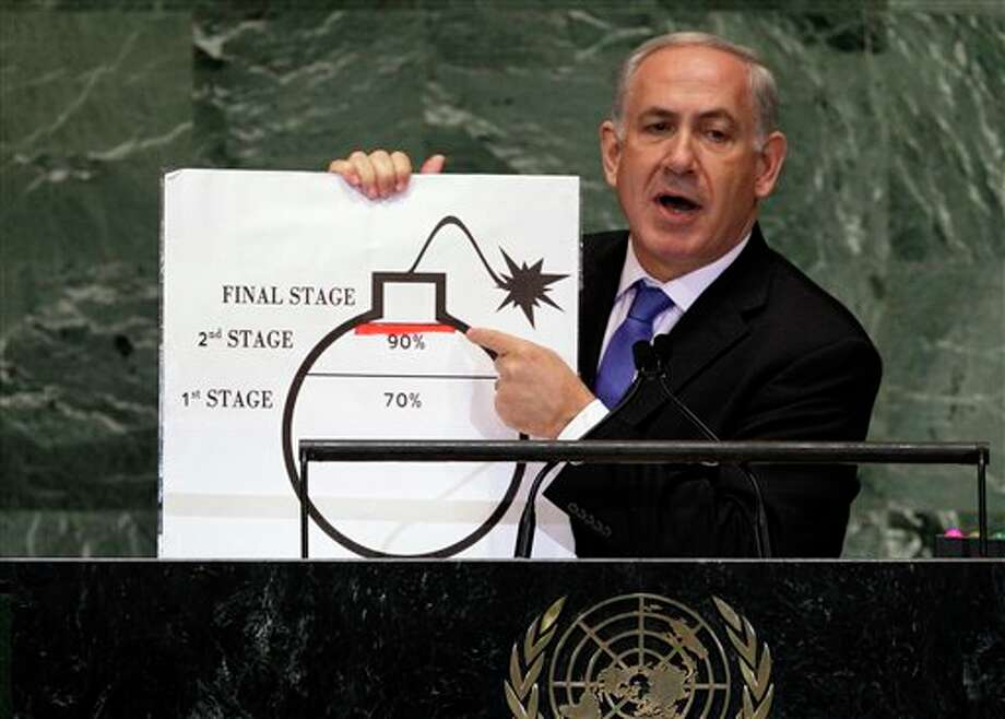 "FILE - In this Sept. 27, 2012 file photo, Israeli Prime Minister Benjamin Netanyahu shows an illustration as he describes his concerns over Iran's nuclear ambitions during his address to the 67th session of the United Nations General Assembly at U.N. headquarters. Iran is considering a more confrontational strategy at possible renewed nuclear talks with world powers, threatening to boost levels of uranium enrichment unless the West makes clear concessions to ease sanctions. Such a gambit outlined by senior Iranian officials in interviews could push Iran's atomic program far closer to Israel's ""red line."" (AP Photo/Richard Drew, File) Photo: Richard Drew / AP"