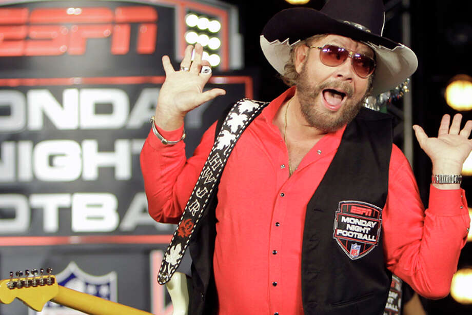 "In this July 14, 2011, file photo, Hank Williams Jr. performs during the recording of a promo for ESPN's broadcasts of ""Monday Night Football,"" in Winter Park, Fla. ESPN is pulling Williams' classic intro song from its broadcast of Monday night's NFL game between the Indianapolis Colts and the Tampa Bay Buccaneers after the country singer famous for the line ""Are you ready for some football?"" used an analogy to Adolf Hitler in discussing President Barack Obama. (AP Photo/John Raoux, File) Photo: John Raoux / AP2011"