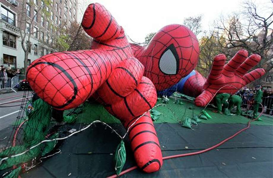 Workers inflate the Spider-Man balloon for the 86th annual Macy's Thanksgiving Day Parade, on New York's Upper West Side, Wednesday, Nov. 21, 2012. More than 3 million people typically attend the event and it has a TV audience of 50 million. (AP Photo/Richard Drew) Photo: Richard Drew / AP