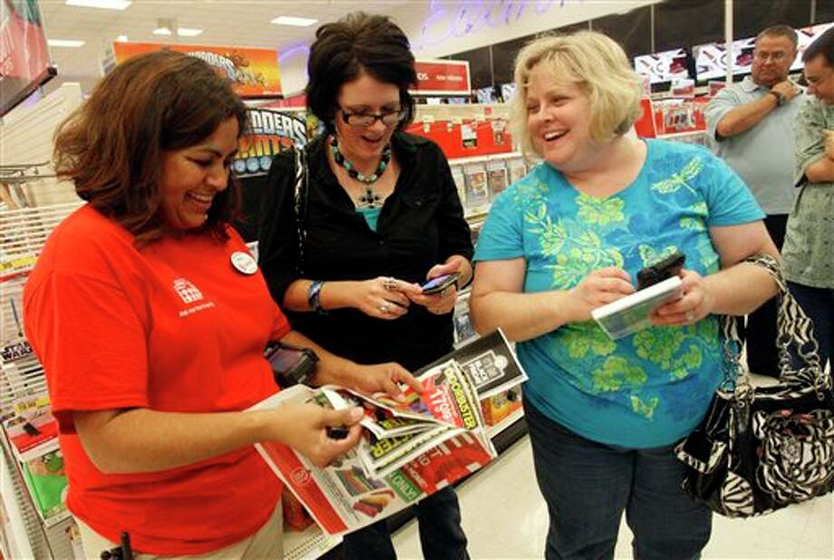 IMAGE DISTRIBUTED FOR TARGET - Target team member Melba Breidenstein assists Angela McCrary and Rebecca Freeman during Black Friday shopping on Thursday, November 22, 2012 in Hurst, Texas. (Richard W. Rodriguez/AP Images for Target) Photo: Richard W. Rodriguez / AP Images