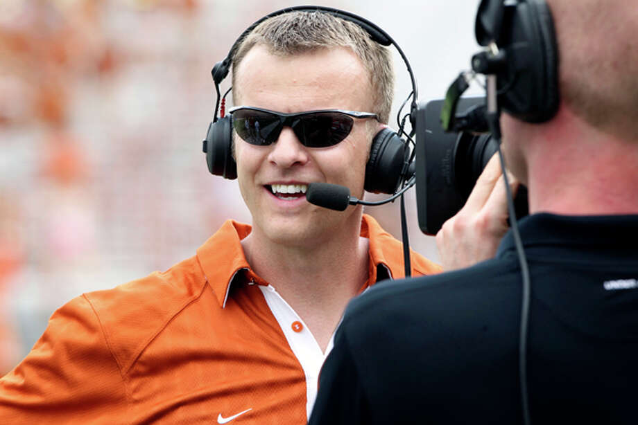 FILE - In this April 3, 2011, file photo, Texas' co-offensive coordinator Bryan Harsin gives an interview during the Texas Orange and White spring NCAA football scrimmage in Austin, Texas. For more than a decade, the Oklahoma Sooners knew pretty much what to expect from the Texas offense. Offensive coordinator Greg Davis was calling the plays in the booth. Now it's Bryan Harsin, whose wacky play calling led Boise State to a stunning Fiesta Bowl upset of the Sooners in 2007. (AP Photo/Michael Thomas, File) Photo: Michael Thomas / AP2011