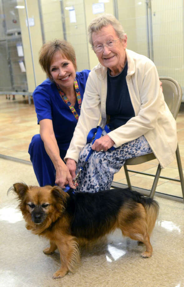 "From left, Midland Human Coalition adoptions manager N. ""Steg"" Stegall and Beulah Verna pose with newly adopted ""Buddy"" Tuesday at Petsmart. James Durbin/Reporter-Telegram Photo: JAMES DURBIN"