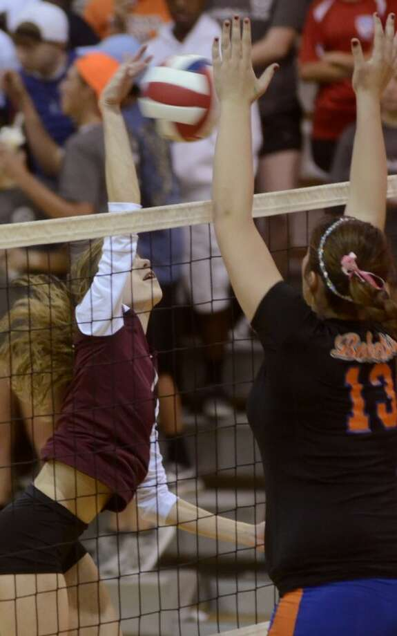 Lee's Stephanie Brewer attempts to put a spike past the reach of San Angelo's Ally Standard Tuesday evening at LHS. Photo by Tim Fischer/Midland Reporter-Telegram Photo: Tim Fischer
