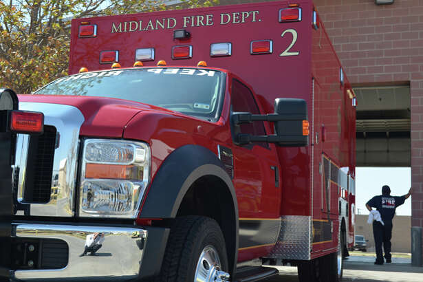Firefighters prepare Midland's first red ambulance for active duty Thursday afternoon at Station 2 located on the 700 block of East Florida Avenue.