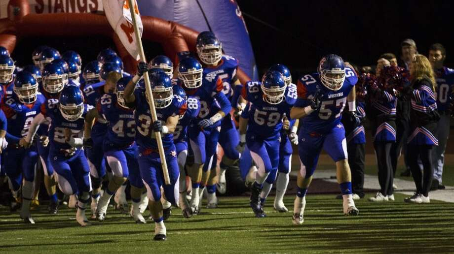 The Midland Mustangs enter the field for their playoff match against the Parish Episcopal Panthers. Photo: Matthew Sewell