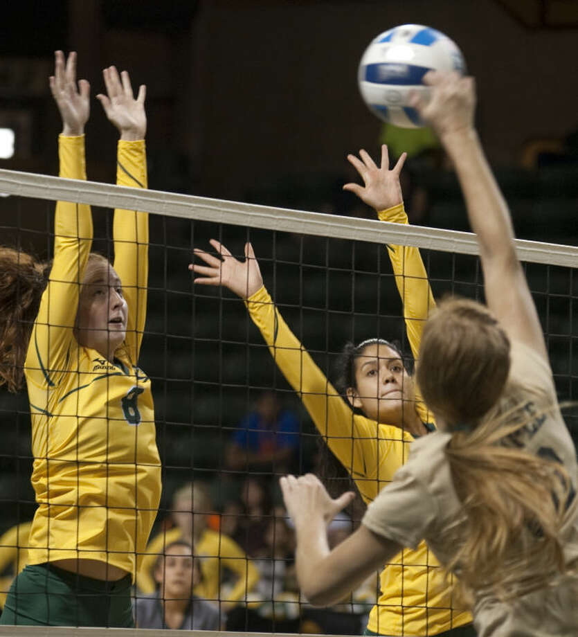 Midland College's Kristina Gafford, 8, and Gaby Nieto, 4, try to block Temple's Mikayla Sheppard Friday in the 2013 Midland College Kick-Off Classic against Temple. Tim Fischer\Reporter-Telegram Photo: Tim Fischer