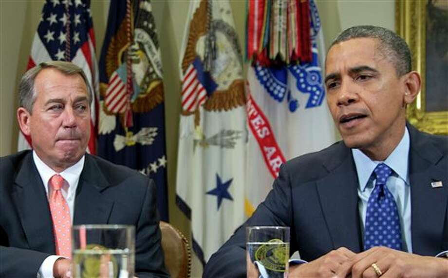 FILE - This Nov. 16, 2012 file photo, President Barack Obama, accompanied by House Speaker John Boehner of Ohio, speaks to reporters in the Roosevelt Room of the White House in Washington. President Barack Obama's re-election has stiffened Democrats' spine against cutting popular benefit programs like Medicare and Social Security. Their new resolve could become as big a hurdle to reaching a deal for skirting economy-crippling tax increases and spending cuts in January as Republicans' resistance raising tax rates on the wealthy. (AP Photo/Carolyn Kaster, File) Photo: Carolyn Kaster / AP