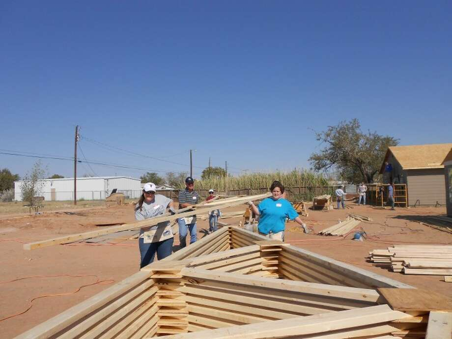 Members of Mid-Cities Community Church build and move trusses for the roof of the home they are helping construct for Habitat for Humanity's Apostles Build. Photo: Courtesy Photo
