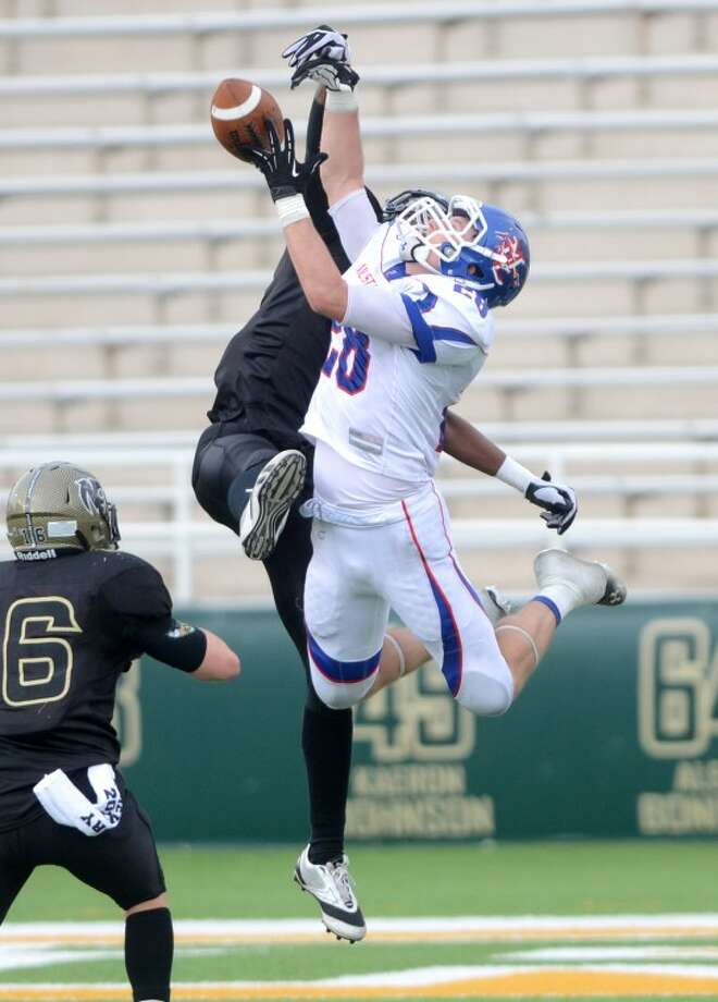 Midland Christian's Jarrod Koym breaks up a pass against Houston Northland in the second half of the TAPPS Division II State Championship game Saturday at Floyd Casey Stadium in Waco, Texas. Midland Christian beat Houston Northland 14-7. James Durbin/Reporter-Telegram Photo: JAMES DURBIN