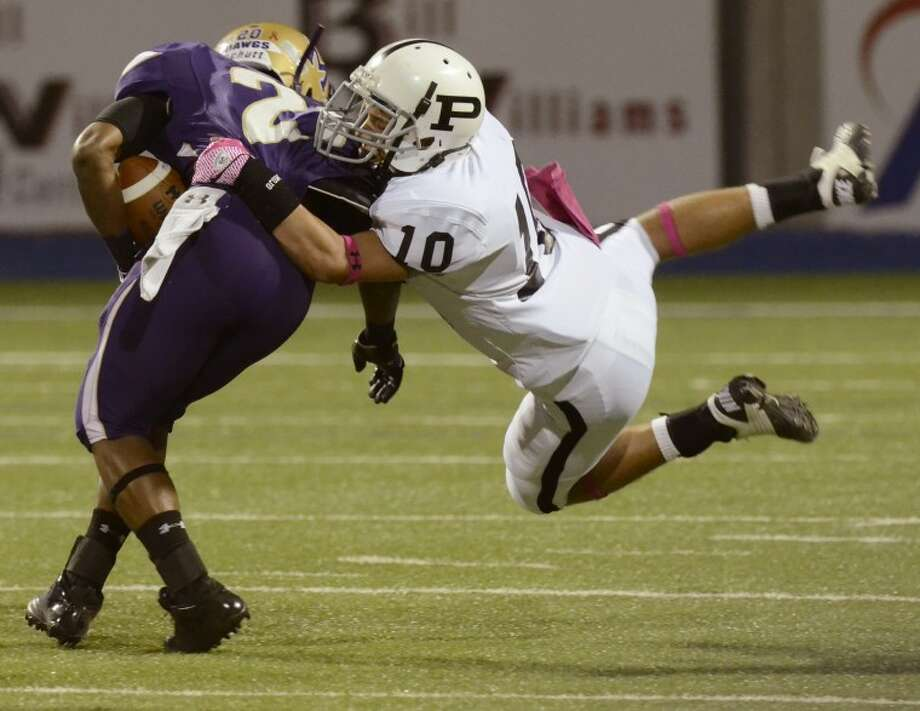 Permian's Tyler Grizzell hangs on as Midland High's Jacoby Webster tries to shake him for extra yards Friday night at Grande Communications Stadium. Photo by Tim Fischer/Midland Reporter-Telegram Photo: Tim Fischer