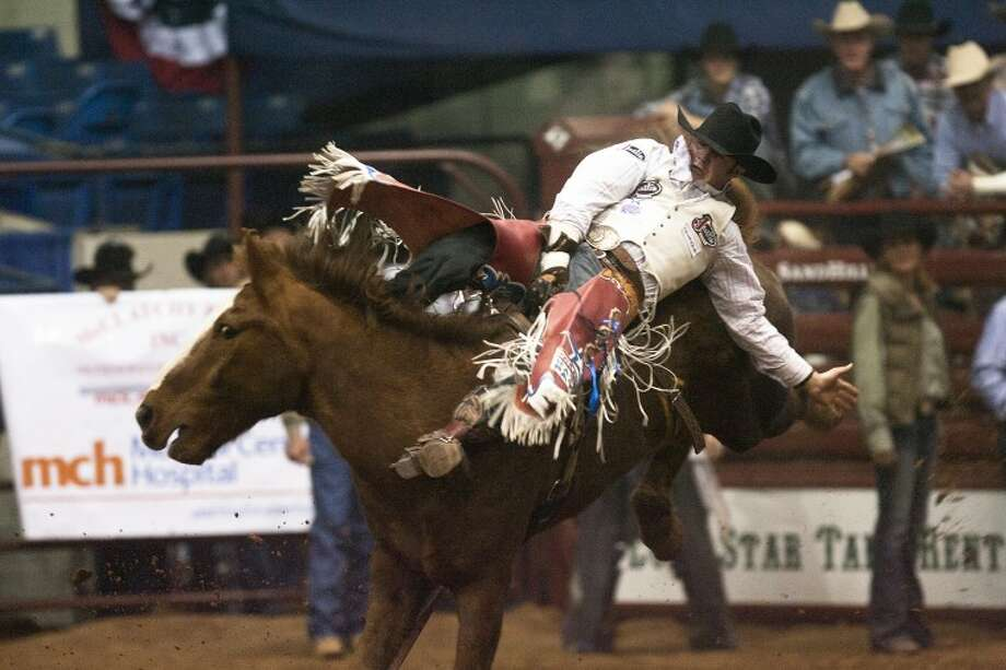 (File Photo) Kaycee Feild scores an 83 on his first Bareback ride during the SandHill Rodeo on Friday night. Albert Cesare|Odessa American Photo: Midland