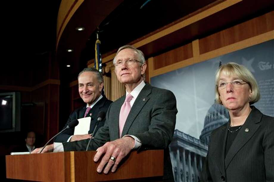 """Senate Majority Leader Harry Reid, D-Nev., and Senate Democratic leaders meet with reporters after talks with Treasury Secretary Timothy Geithner on the fiscal cliff negotiations, at the Capitol in Washington, Thursday, Nov. 29, 2012. """"We're still waiting for a serious offer from Republicans,"""" said Reid. He is joined by Sen. Charles Schumer, D-N.Y., left, and Sen. Patty Murray, D-Wash., right. The """"fiscal cliff"""" is a combination of tax increases and spending cuts worth about $670 billion that will take effect at the start of next year unless Congress and the White House agree to postpone or replace them. (AP Photo/J. Scott Applewhite) Photo: J. Scott Applewhite / AP"""