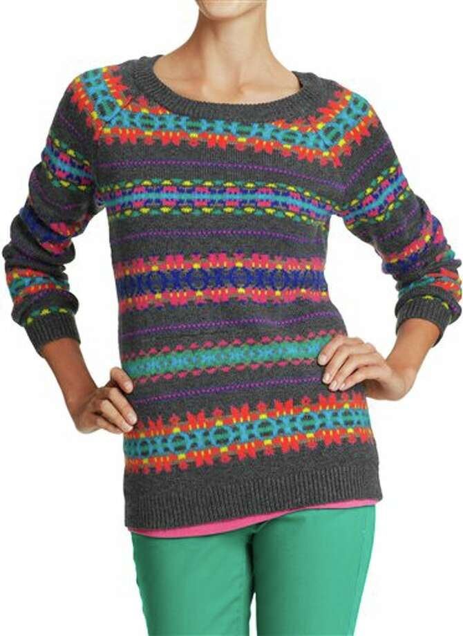 "This undated publicity photo provided by Old Navy shows a rib-knit crew neck, cuffs and hem sweater of soft, medium-weight cotton blend with an overall fair-isle-inspired pattern, available at Old Navy. The good, the bad, the kitschy. A ""seasonal sweater"" is one way to start a conversation at a holiday function. (AP Photo/Old Navy) Photo: HOEP / Old Navy"