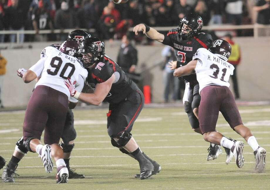 Texas Tech quarterback Seth Doege gets hammered by Texas A&M defender Howard Matthews just as he unloads a pass Saturday night in Big XII action. The Aggies went on to win the game 45-40. Photo: Wade H Clay