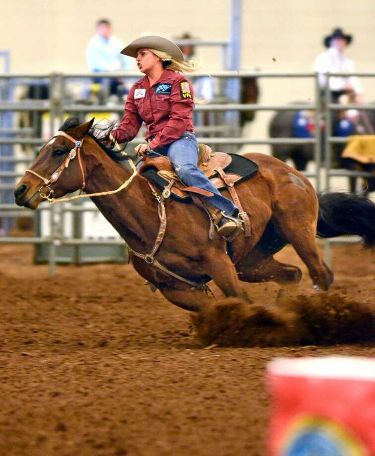 Jessica Nantz-Beck of the US Navy competes in Ladies Barrel Racing during the Professional Armed Forces Rodeo Association event Saturday at Horseshoe Arena. Nantz-Beck won the event, completing the course with a time of 16.1 seconds. James Durbin/Reporter-Telegram Photo: JAMES DURBIN