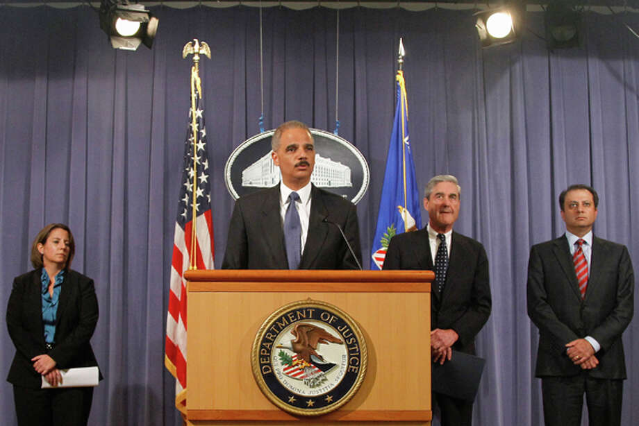 Attorney General Eric Holder, second from left, speaks during a news conference at the Justice Department in Washington, Tuesday, Oct. 11, 2011. Holder announced that two individuals have been charged in New York for their alleged participation in a plot directed by elements of the Iranian government to murder the Saudi Ambassador to the United States with explosives while the ambassador was in the United States. From left are Assistant Attorney General for National Security Lisa Monaco, FBI Director Robert Mueller and U.S. Attorney for the Southern District of New York Preet Bharara. (AP Photo/Haraz N. Ghanbari) Photo: Haraz N. Ghanbari / AP